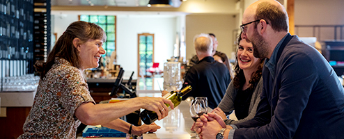 Customers enjoying a tasting at the tasting bar