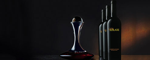 Col Solare wine bottles and decanter