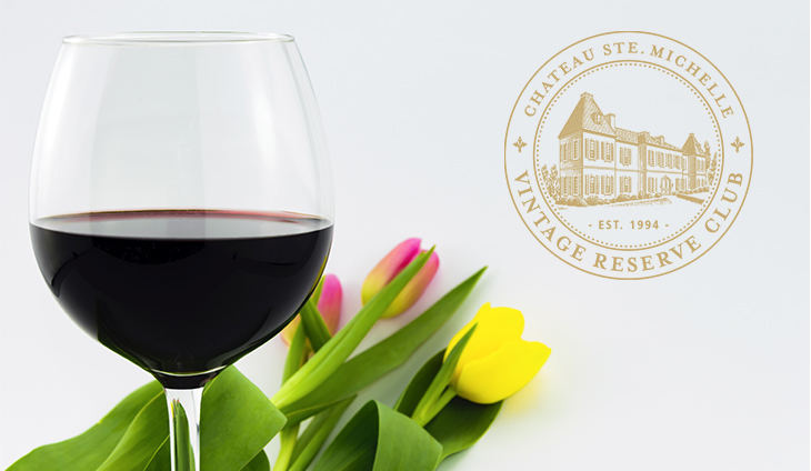 Glass of wine with tulips.