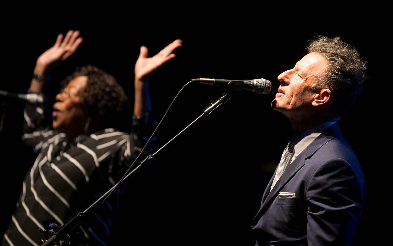 Lyle Lovett singing into a microphone