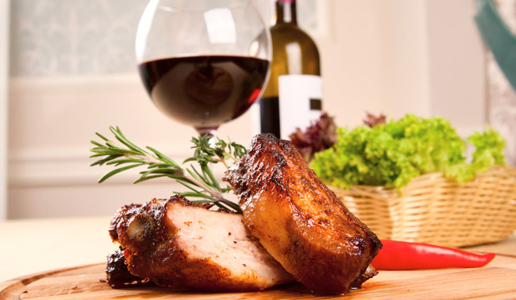 Pork dinner with a glass of wine