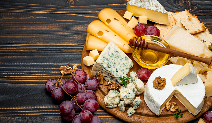 Assorted cheeses on a cheese board