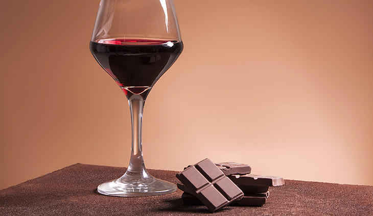 Glass of red wine with chocolate