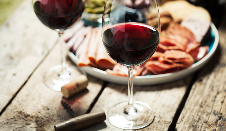 Glass of Red Wine with food.
