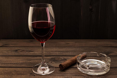 Glass of wine and cigar